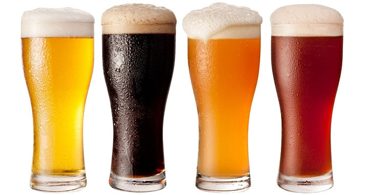 4 glasses of different beers.