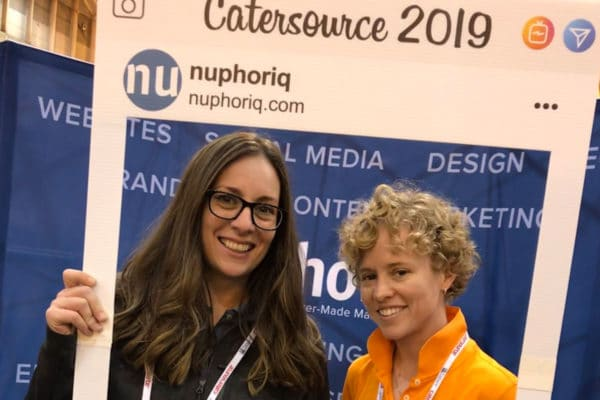 Erin *& Jamie holding the instagram sign at the nuphoriq booth