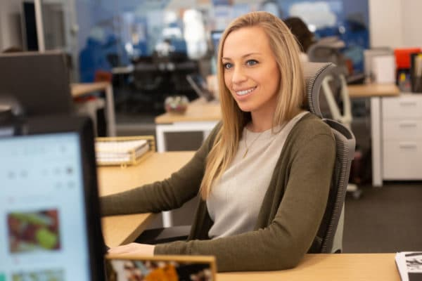 Karen working at her desk