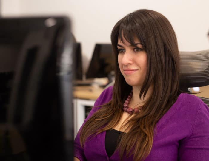 sarah, nuphoriq's lead copywriter, writing content for a client